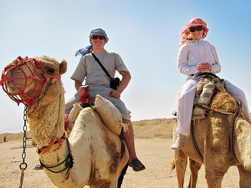 Westerners traveling by camel